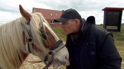 Christian Roll und Kollege Tamme. Kollege Tamme ist ein Pferd.