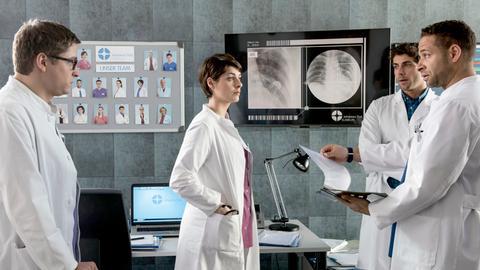Die Ärzte besprechen den anstehenden Tag.