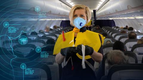 Flugbegleiterin mit Mundschutz