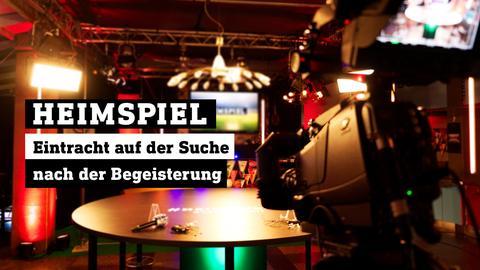 Blick ins leere Heimspiel-Studio. Text: Heimspiel | Eintracht auf der Suche nach der Begeisterung.
