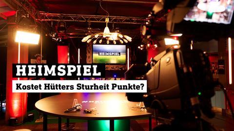 Blick ins heimspiel-Studio. Text: Kostet Hütters Sturheit Punkte?