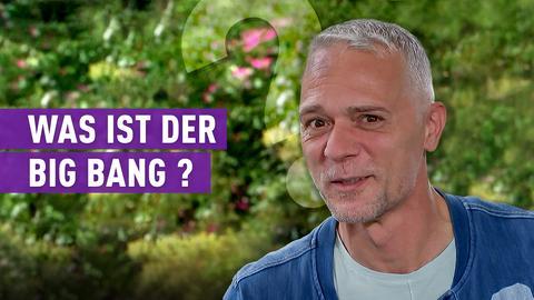 """strassenstar-Kandidat mit Schriftzug: """"Was ist der Big Bang?"""""""