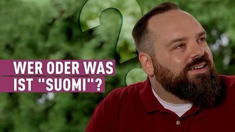 """strassen stars-Kandidat mit Bart und rotem T-Shirt. Schriftzug: Wer oder was ist """"Suomi""""?"""