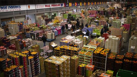 A general view of the fruits and vegetables pavilion at Rungis International wholesale food market as buyers for restaurants and retail distributors prepare for the Christmas holidays, in Rungis, near Paris
