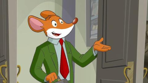 Geronimo Stilton in einem grünen Anzug und einer roten Krawatte.