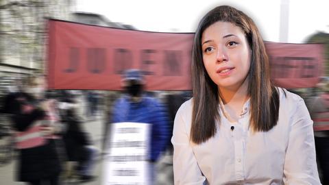 Protagonistin Tamara im Vordergrund. Im Hintergrund verschwommen: Menschen auf einer Demo.